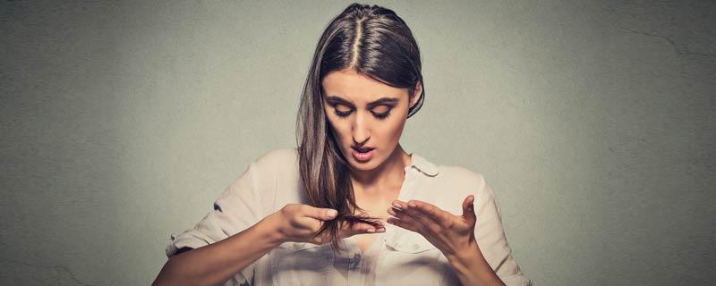 woman-looking-at-hair