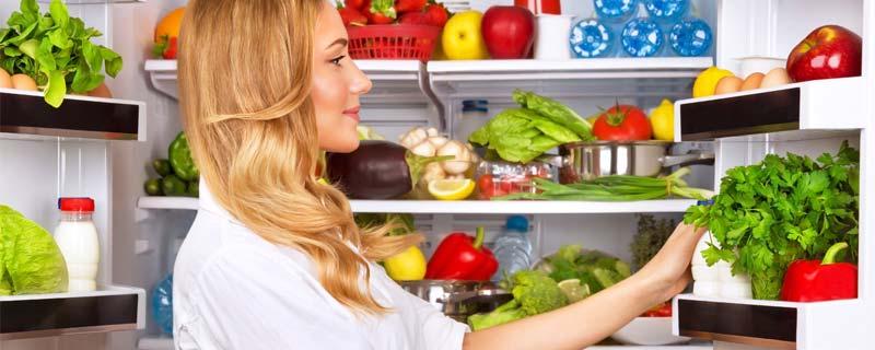 woman-looking-in-fridge